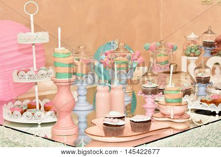 Sweet table with donuts, marshmallows, muffins, cake pops