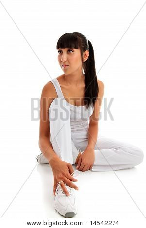 Young Woman Sitting Wearing Fitness Exercise Clothing.