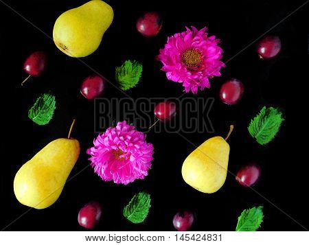 Composition made of fresh flowers, pears and plums.