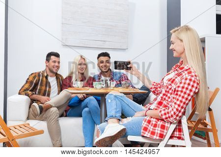 People taking selfie friends pictures drinking coffee shop with barista sitting table mix race men hold smart phone woman happy smile