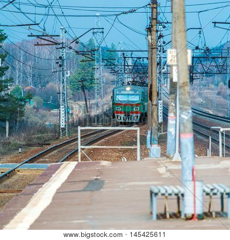Russian Suburban Passenger Train Arriving To Station