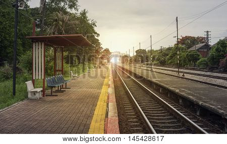 View Of The Length Of Railway With Pavement At Left Side Of Railway,filtered Image, Light Effect And