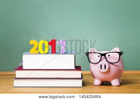 Class Of 2017 Theme With Textbooks And Piggy Bank