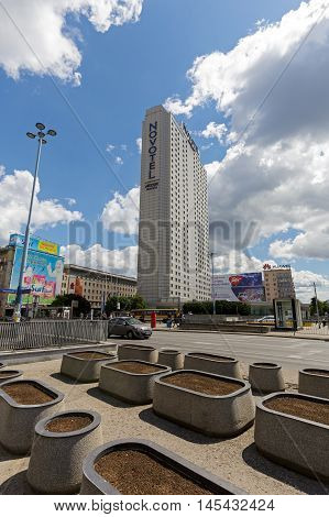 WARSAW POLAND - JUNE 11 2016: Skyscraper was built for Orbis next has been named Novotel and entered to Hotel Group Accor. It is one of the largest hotels in the city was opened in 1974