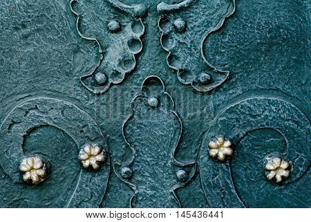 embossed metallic green-blue background with baroque details and with buttons and metal gold  flowers
