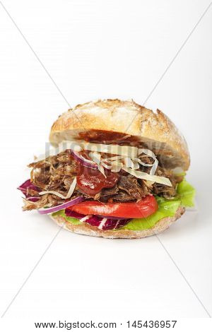 pulled pork in a bun on white