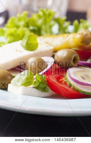 closeup of fresh greek salad with olives
