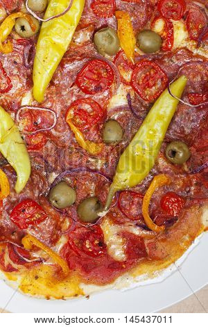 detail of a pizza with peperoni on a plate