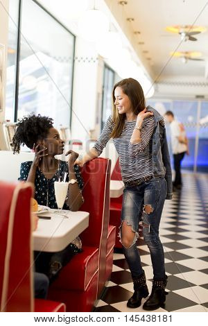 Multiracial Women In The Diner