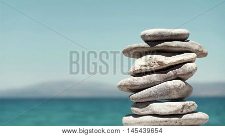 Stack of Sea Pebbles on a Calm Sea Background