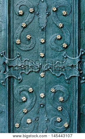 embossed metallic green blue background with baroque details and with buttons and metal gold  flowers