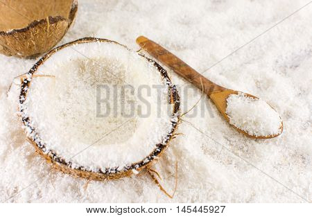 Halved Fresh Coconut And Powder On The Table