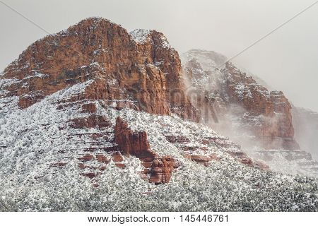 snow form a winter storm blankets the red rocks of sedona arizona