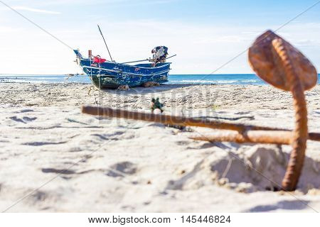 Old fishing boat on the beach in Thailand.