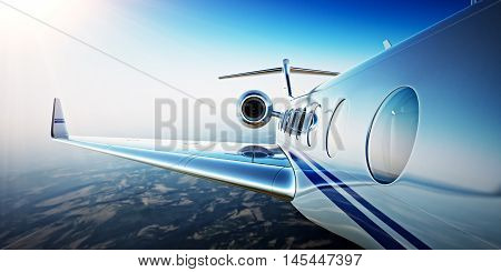 Closeup Photo of White Luxury Generic Design Private Aircraft Flying in Blue Sky at sunrise.Uninhabited Desert Mountains Background.Business Travel Picture.Horizontal, Film Effect. 3D rendering