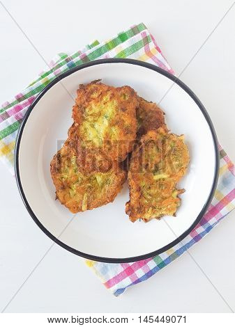 mucver, traditional turkish zucchini frittters meal on a white background