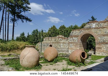 View to restored inside park of  castle Hisarlak with earthen  vessel, near by Kyustendil town, Bulgaria
