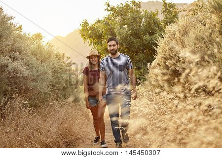 Young Couple Walking On A Mountain Path