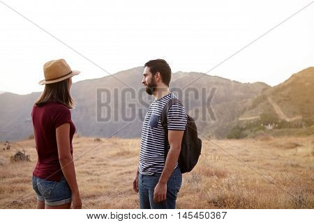 Couple Standing On Plato On Mountain