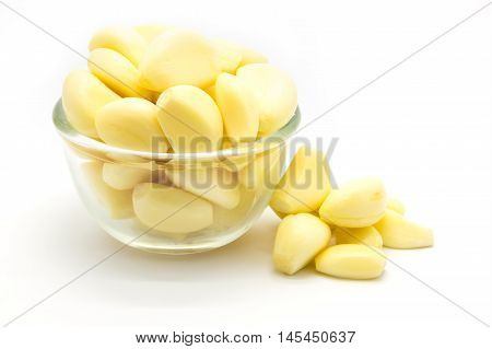 Fresh raw garlic on glass blow, on white background