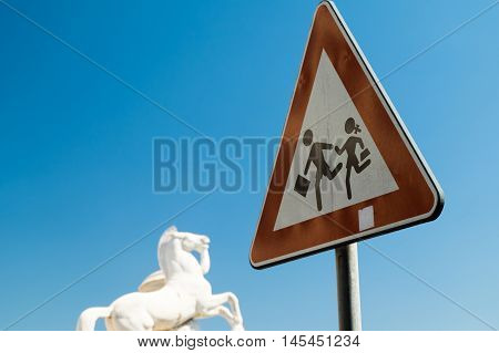 Children safety red Sign with horse monument near Rome