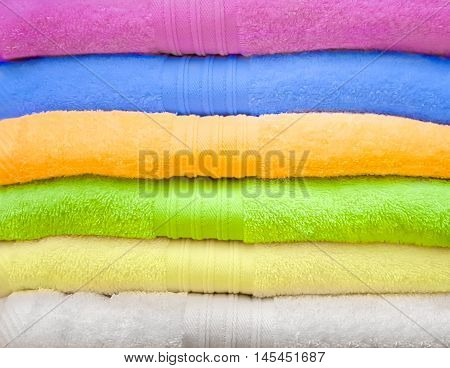 Big pile of colorful towels. Background of towels
