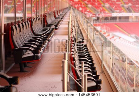 MOSCOW - DEC 25, 2014: Bright red seats of grandstands covered by snow in new Spartak stadium. Stadium capacity - 45 000 people. Stadium was built in 2010-2014