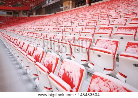 MOSCOW - DEC 25, 2014: Rows of red snowy seats in new Spartak stadium. Stadium capacity - 45 000 people. Stadium was built in 2010-2014