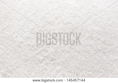 Granulated white sugar texture or background, top view