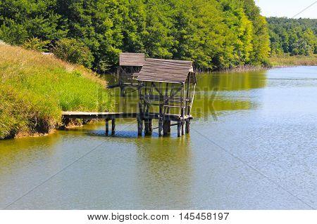 Gazebo on the wooden pier on lake