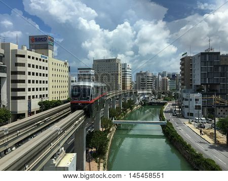 Okinawa Monorail (Yui-Rail) is an only rail transport in Naha City, Okinawa, Japan. It's approaching Asahibashi station in the morning of  July 26, 2016.