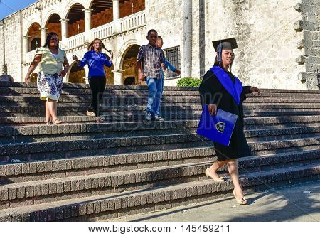 SANTO DOMINGO, DOMINICAN REPUBLIC - January 24, 2016: Happy graduate girl near Alcazar in Colonial Zone of Santo Domingo, Dominican Republic.