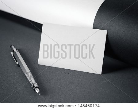 White blank business card with pen on gray floor. 3d rendering