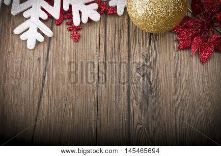 Christmas frame with stars snow and christmas balls on wood table