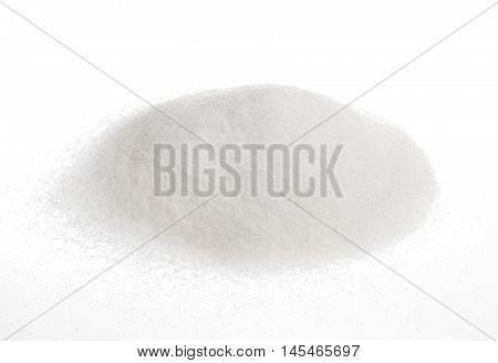Close-up of pile of sugar isolated on a yellow background