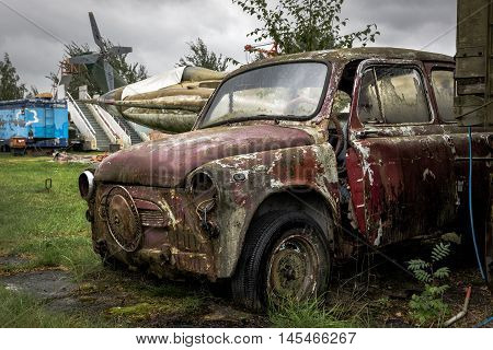 Old rusty crashed and abandoned car on rubbish yard