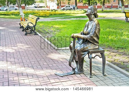 BELGOROD RUSSIA - August 31.2016: Amusing sculpture of an elderly woman who knits a scarf in a city park