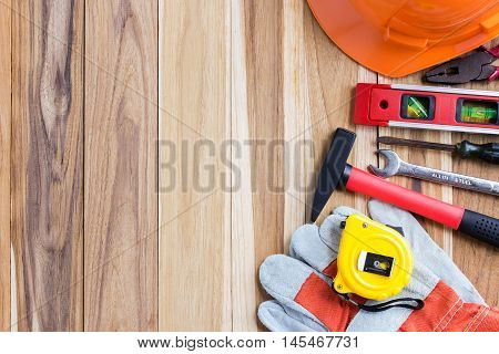 Safety equipment and tool kit on wooden table background with copy space