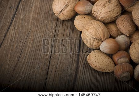 Fresh group of nuts on the wooden table