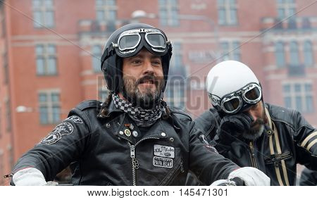 STOCKHOLM SWEDEN - SEPT 03 2016: Closeup of two bikers wearing leather clothes at the Mods vs Rockers event at the St:Eriks bridge Stockholm Sweden September 02 2016