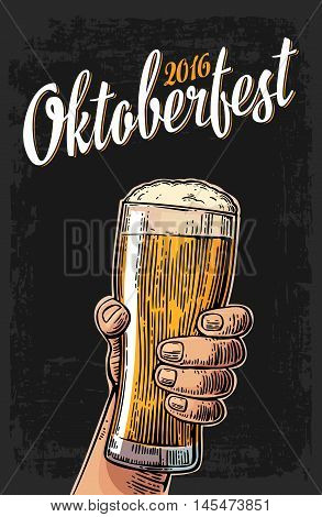 Male hand holding a beer glass. Vintage vector engraving illustration for web poster invitation to oktoberfest festival. Isolated on dark background