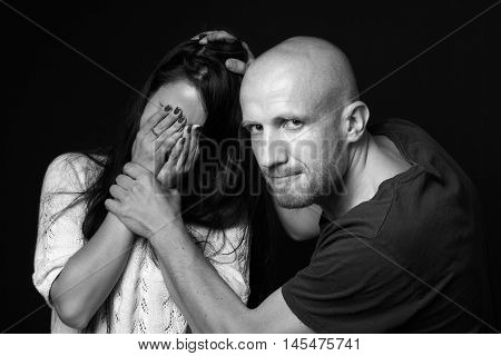 Domestic violence to woman, image on black background