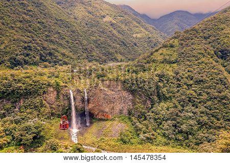Tourist Gliding On The Zip Line Trip Against Bridal Veil Also Known As Manto De La Novia Waterfall In Cascades Route Banos De Agua Santa Ecuador