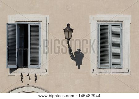 Shutters and street light in the city of Rome