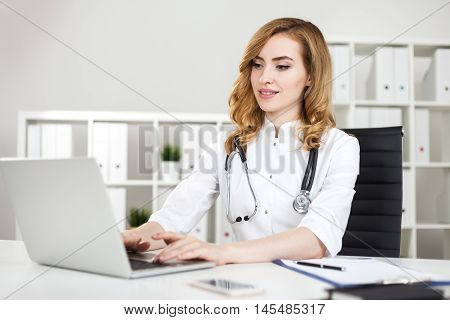 Thinking Woman Doctor With Laptop