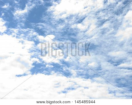 White clouds on blue sky. Sky with clouds. The clouds in the sky. Clouds background. Sky background.