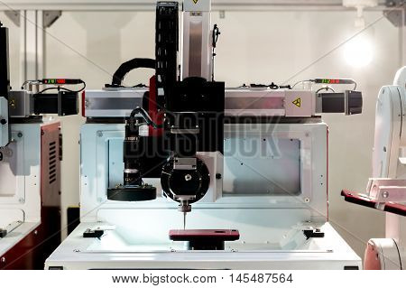 Video precision measuring industry machine working in manufacturing industry factory.