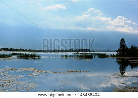 Lake With Cloudy Sky Reflection