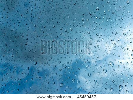 water drops on blue background / Drops of rain on glass , rain drops on clear window / Blue Abstract Water Drops Background / water drops on glass surface as background.