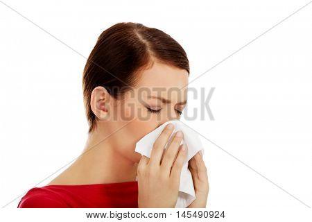 Young beautiful caucasian woman sneezing